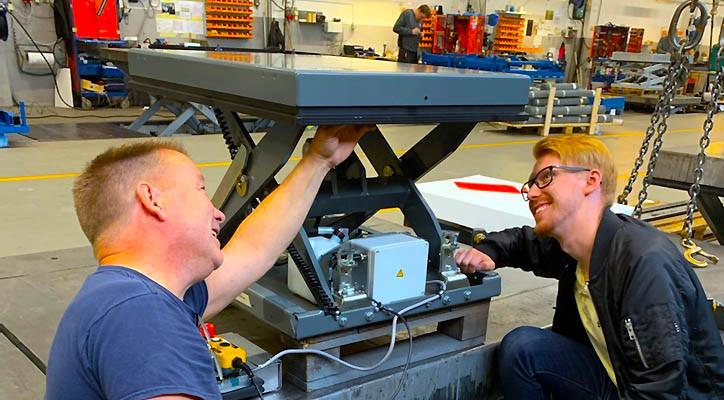 Fredrik Johansson (R), project manager, examines the prototype for the new M0