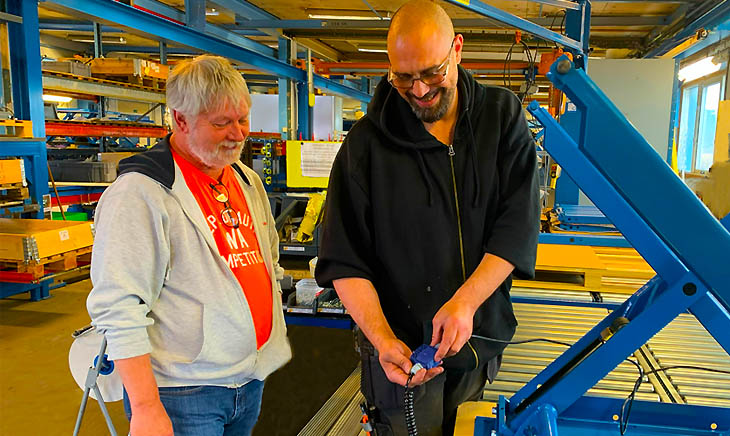 Flemming (L) and Alexander discuss improved cable routing